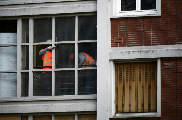"Workers have already started breaking down the housing estate to make way for a new ""green district"" of energy-efficient buildings and parks (AFP Photo/Philippe LOPEZ)"