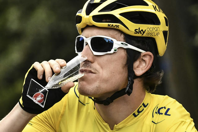 Britain's Geraint Thomas drinks Champagne during the 21st and last stage of the 105th edition of the Tour de France cycling race between Houilles and Paris Champs-Elysees, Sunday, July 29, 2018. (Marco Bertorello, Pool via AP)
