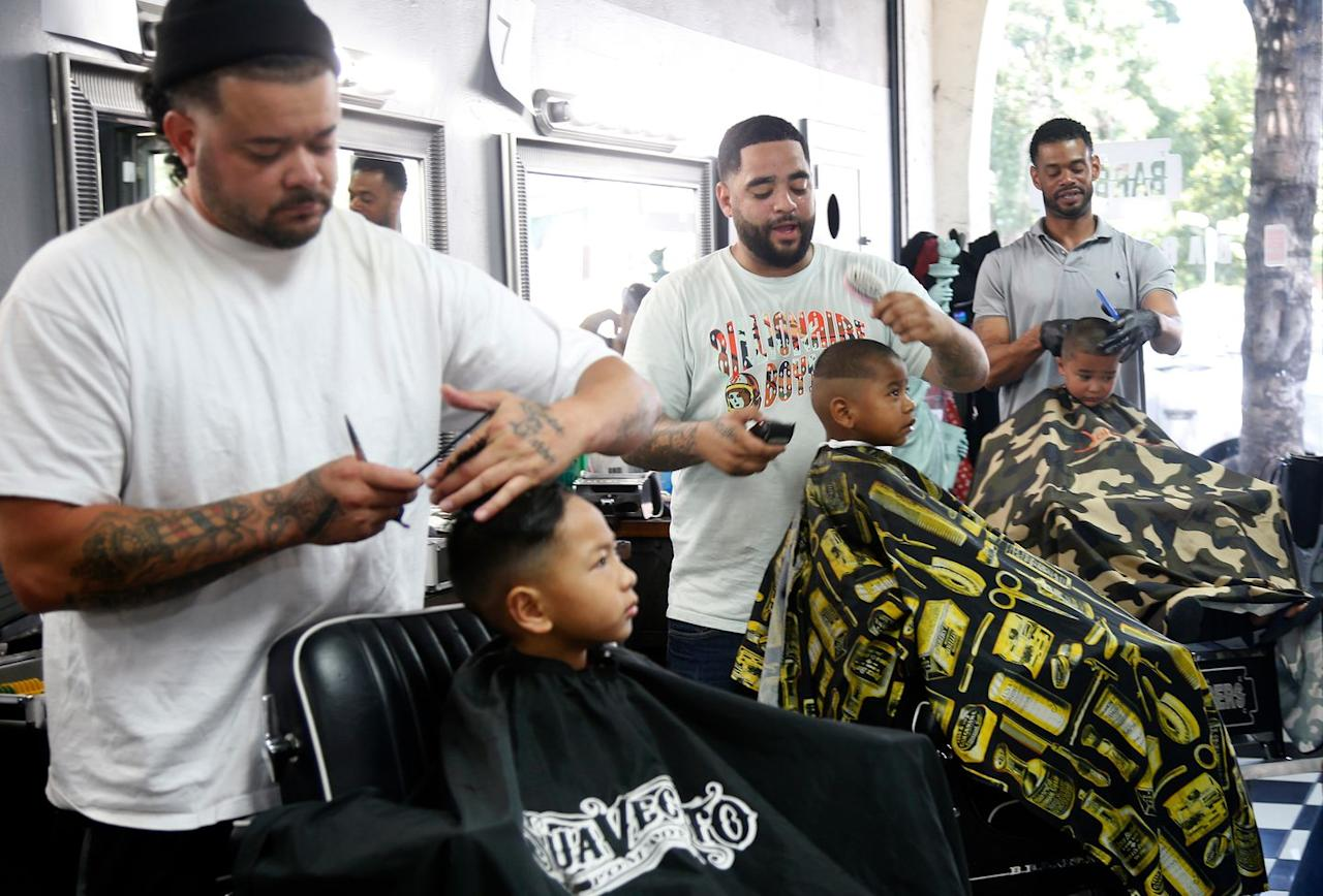 "<p>Anthony Ledesma, Victor Erwin, and Aaron Flowers (from left) volunteered their talents at the sixth annual Kutz4Kids event this August in San Jose, California. Fifteen barbers gave out hundreds of free <a rel=""nofollow"" href=""https://www.goodhousekeeping.com/life/parenting/a20159833/baby-first-haircut/"">haircuts for students</a> returning to school.</p>"