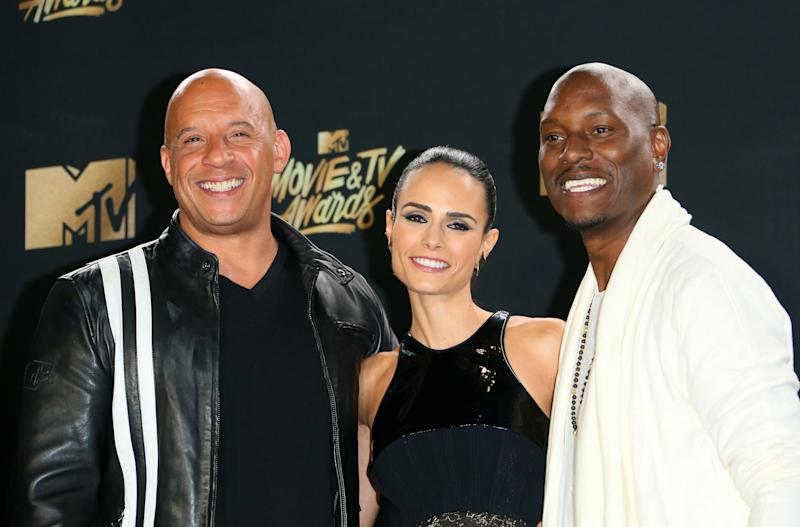 "(L-R) Actors Vin Diesel, Jordana Brewster and Tyrese Gibson, winners of the Generation Award, pose in the press room at the 2017 MTV Movie and TV Awards"" At the Shrine Auditorium, in Los Angeles, California, on May 7, 2017. / AFP PHOTO / JEAN-BAPTISTE LACROIX (Photo credit should read JEAN-BAPTISTE LACROIX/AFP/Getty Images)"