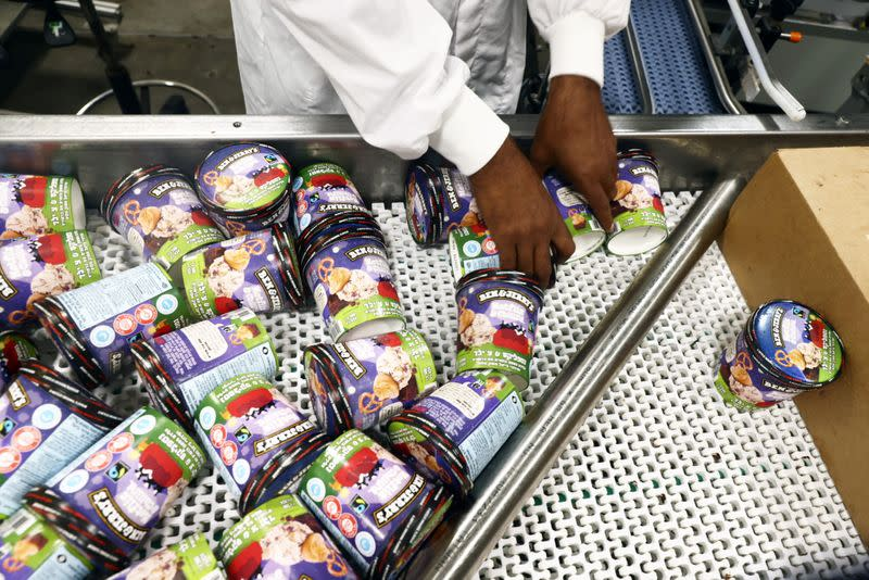 A worker handles tubs of Ben & Jerry's ice-cream at their factory in Be'er Tuvia, Israel