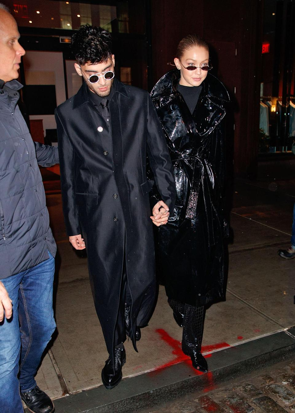 All black and tiny sunglasses? The perfect recipe for a killer couple look.