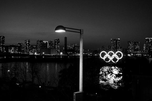 Illuminated Olympic rings float in the water in the Odaiba section of Tokyo, March 6, 2020. (AP Photo/Jae C. Hong)