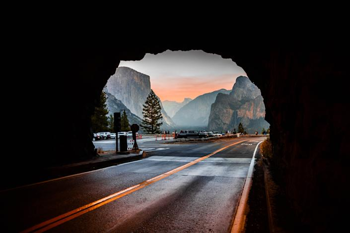 """<h1 class=""""title"""">The Yosemite Tunnel view from inside tunnel road during sunset.</h1> <div class=""""caption""""> Road-trippers park along a route in California's Yosemite Park to take in the view. </div> <cite class=""""credit"""">Photo: Artur Debat / Via Getty Images</cite>"""