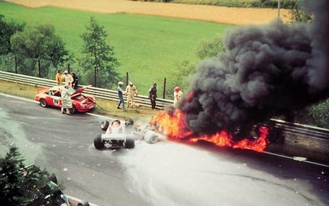 Niki Lauda's accident at Nurburgring...Picture of the burning Ferrari of Austrian Formula 1 world champion Niki Lauda after an accident on the 1st of August in 1976 at Nurburgring. Lauda escaped death in the last second, he was pulled out of the burning wreck by his Formula 1 rivals. No third party sale - Credit: ATP
