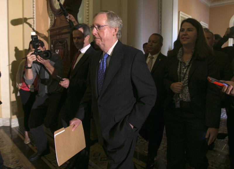 Senate Minority leader McConnell is trailed by reporters as he walks to the Senate Chamber in the U.S. Capitol in Washington