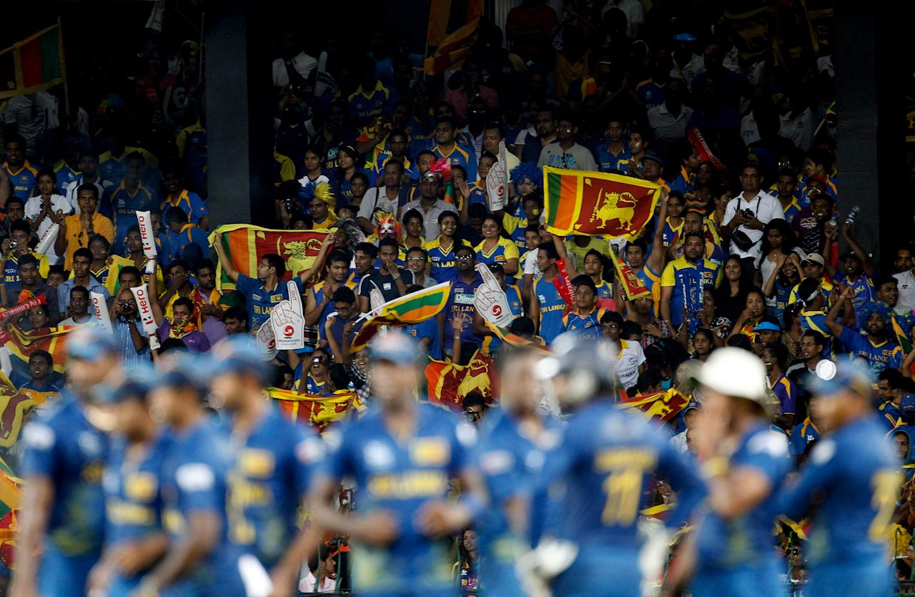 COLOMBO ,SRI LANKA - OCTOBER 7: Sri Lanka fans cheer during the ICC  World Twenty20 2012 Final between Sri Lanka and West Indies at R. Premadasa Stadium on October 7, 2012 in Colombo, Sri Lanka.(Photo by Graham Crouch-ICC/ICC via Getty Images)