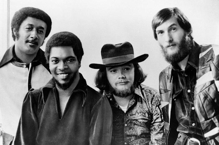 """FILE - Soul rockers Booker T and the MGs are seen in this Jan. 1970 file photo, from left to right: Al Jackson, Jr., Booker T. Jones, Donald """"Duck"""" Dunn, and Steve Cropper. Bass player and songwriter Donald """"Duck"""" Dunn, a member of the Rock 'n' Roll Hall of Fame band Booker T. and the MGs and the Blues Brothers band, died in Tokyo Sunday May 13, 2012. He was 70. (AP Photo, File)"""