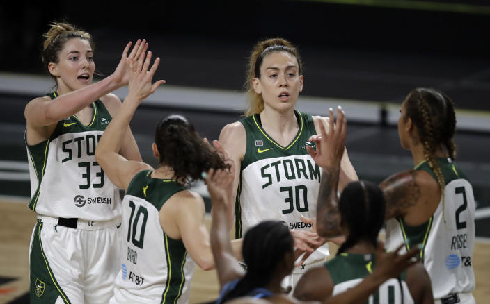 Seattle Storm players, including Katie Lou Samuelson (33) and Breanna Stewart (30), celebrate a score against the Atlanta Dream in the second half of a WNBA basketball game Friday, June 11, 2021, in College Park, Ga. (AP Photo/Ben Margot)