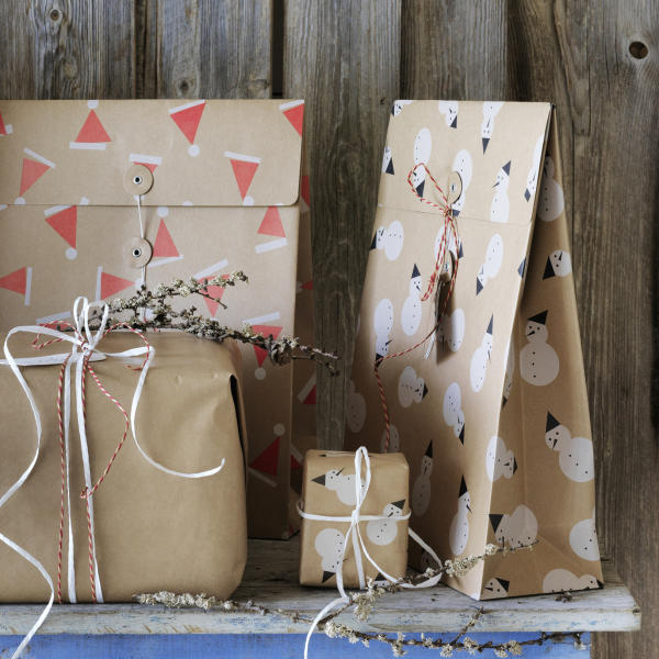 This photo provided by IKEA shows their reusable Vinter Gift Bags. While the holiday season is a time of giving and thoughtfulness, it can also be a time of excess and waste. Americans throw away 25 percent more trash than usual between Thanksgiving and New Year's, that's about a million extra tons of garbage each week, according to the National Environmental Education Foundation (NEEF), a Washington, D.C.-based nonprofit group devoted to helping people to be more environmentally responsible. (IKEA via AP)