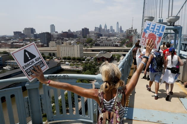 Demonstrators make their way to downtown on the Benjamin Franklin Bridge in Philadelphia on Monday, during the first day of the Democratic National Convention. Alex Brandon / AP