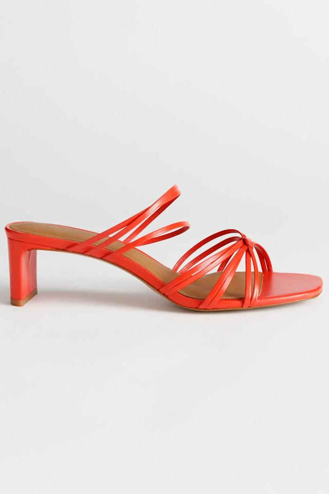 """<p><a class=""""body-btn-link"""" href=""""https://www.stories.com/en_gbp/shoes/heeled-sandals/product.strappy-knotted-heeled-sandals-tomato-orange.0748652002.html"""" target=""""_blank"""">SHOP NOW</a></p><p>These fun orange shoes will instantly elevate any ensemble.</p><p><em> Knotted sandals, £79, & Other Stories</em></p>"""