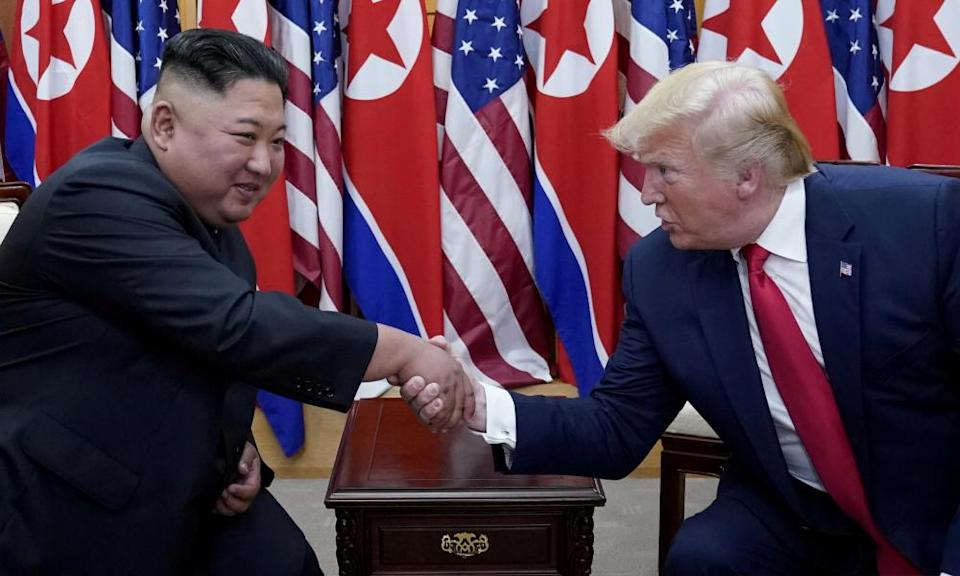 """<span class=""""element-image__caption"""">Donald Trump shakes hands with Kim Jong-un at the demilitarized zone separating the two Koreas, in June 2019.</span> <span class=""""element-image__credit"""">Photograph: Kevin Lamarque/Reuters</span>"""
