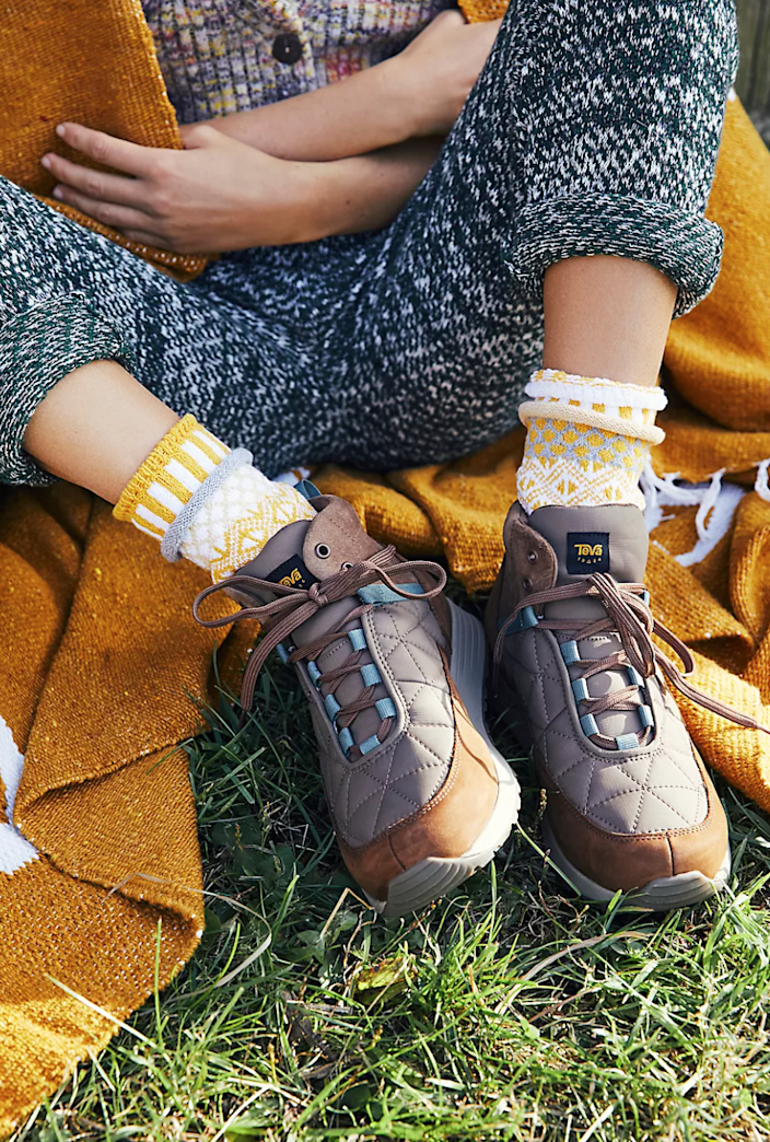 """<h2><a href=""""https://www.freepeople.com/shop/teva-ember-commute-mid-boots/?color=020&type=REGULAR&quantity=1"""" rel=""""nofollow noopener"""" target=""""_blank"""" data-ylk=""""slk:Teva Ember Commute Mid Boots"""" class=""""link rapid-noclick-resp"""">Teva Ember Commute Mid Boots<br></a></h2><br>For the MIL who's rekindled her relationship with mother nature after a year of social distancing, these fashionably functional, all-weather leather boots will definitely come in handy. <br><br><strong>Teva 
