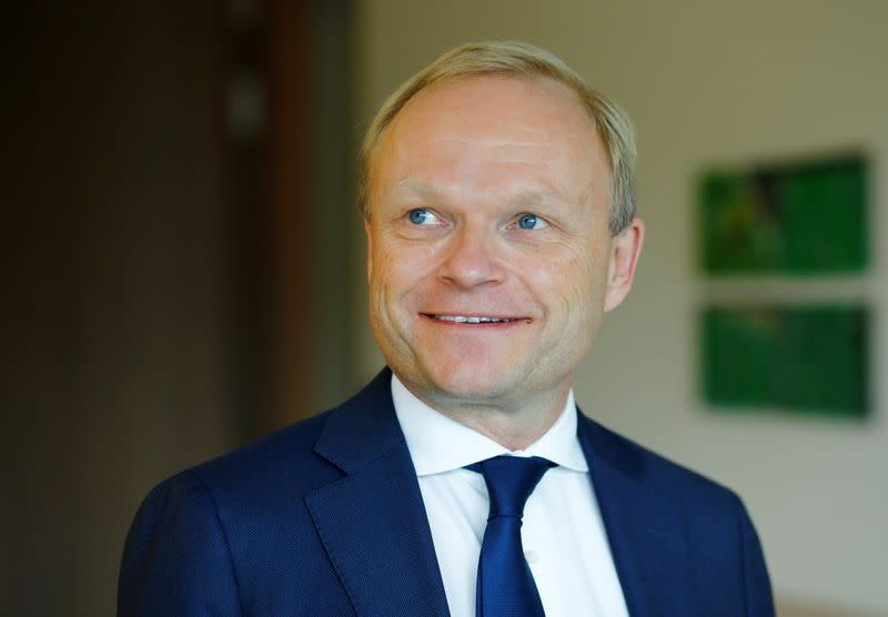 FILE PHOTO: Pekka Lundmark, president and CEO of Finnish state-controlled utility Fortum, poses after a news conference in Duesseldorf