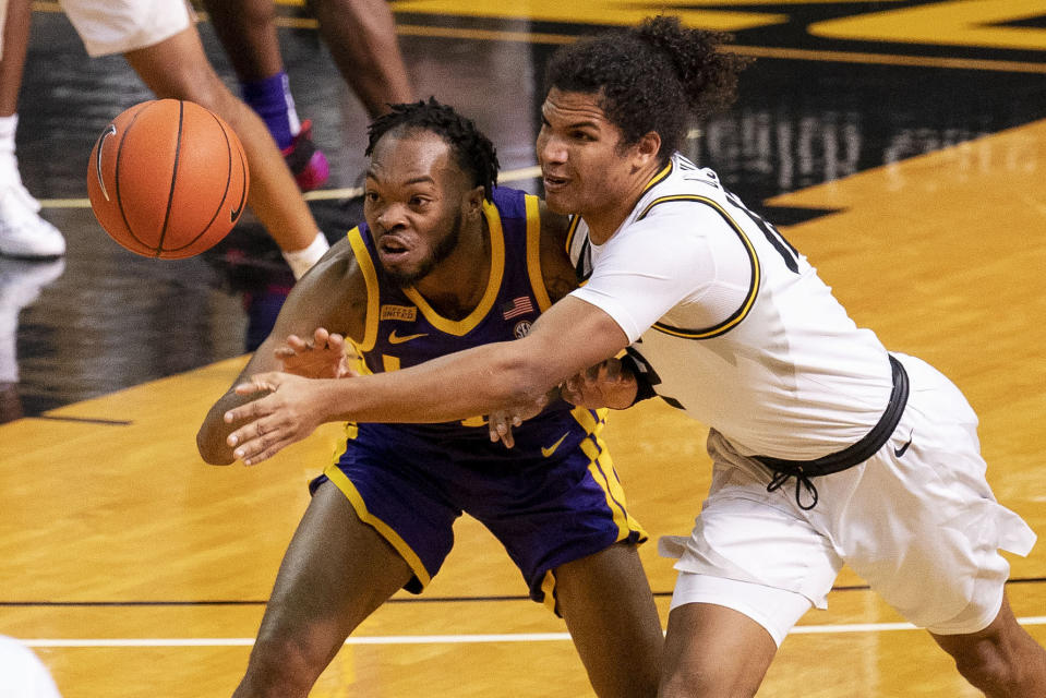LSU's Javonte Smart, left, battles Missouri's Dru Smith, right, for a loose ball during the first half of an NCAA college basketball game Saturday, March 6, 2021, in Columbia, Mo. (AP Photo/L.G. Patterson)