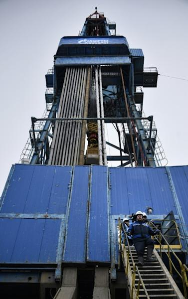A worker walks down the stairs of a gas drilling rig at the Bovanenkovo gas field on the Yamal peninsula in the Arctic Circle