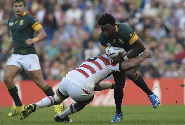South Africa's wing Lwazi Mvovo (R) is tackled during a Pool B match of the 2015 Rugby World Cup between South Africa and Japan at the Brighton community stadium, south east England on September 19, 2015 (AFP Photo/Lionel Bonaventure)
