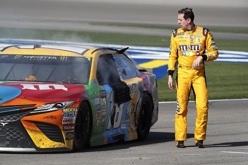 Kyle Busch walks away from his smoking car in pit lane at the end of the NASCAR Cup Series auto race at Las Vegas Motor Speedway on Sunday, March 12, 2017, in Las Vegas. (Steve Marcus/Las Vegas Sun via AP)