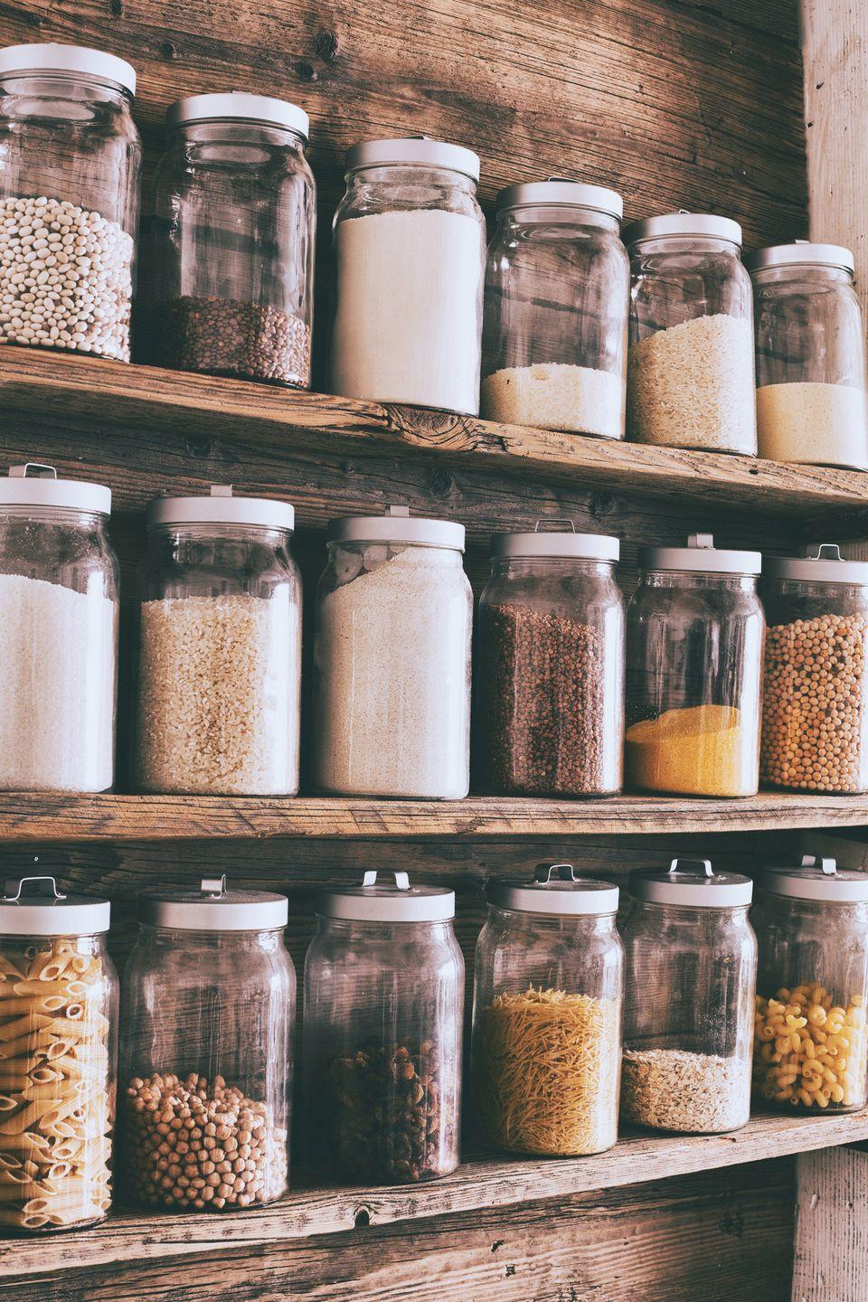 """<p>You can't stay efficient and organized while cooking in a messy kitchen that's completely disorganized. When you start searching for ingredients you need or tearing apart drawers looking for one specific tool, you're wasting time and making the process longer. Chef <a href=""""https://mymillennialkitchen.com/"""" rel=""""nofollow noopener"""" target=""""_blank"""" data-ylk=""""slk:Michele Sidorenkov"""" class=""""link rapid-noclick-resp"""">Michele Sidorenkov</a>, RDN, of My Millennial Kitchen, says, """"You should really focus on organizing your kitchen in a way where items make sense together. In my kitchen at home, I have my knives, cutting boards, measuring spoons, and prep bowls all together in one place. Having those items easily on hand means I am not running from one side of the kitchen to the other for items I would be using all together."""" </p>"""