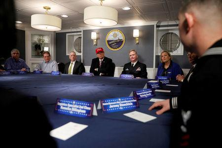 President Trump and Defense Secretary James Mattis receive a briefing with Commanding Officer U.S. Navy Captain Rick McCormack (2nd R) and Susan Ford Bales (R) aboard the pre-commissioned U.S. Navy aircraft carrier Gerald R. Ford. REUTERS/Jonathan Ernst