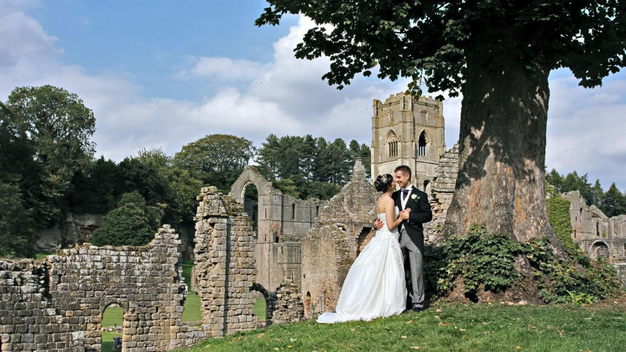 """<p>Founded in 1132, the <a href=""""https://www.nationaltrust.org.uk/fountains-abbey-and-studley-royal-water-garden/features/weddings-at-fountains"""">Fountains Abbey</a> near Ripon, Yorkshire, operated for over 400 years, until Henry VIII ordered the Dissolution of the Monasteries. Now you can hire out the nearby Fountains Hall for your wedding ceremony, have drinks in the private walled garden and enjoy the Abbey ruins at your leisure. The location is sure to provide some cracking wedding snaps. Weddings from £1,080 for 20 guests (maximum capacity of 80 guests). [Photo: National Trust Images/Charles Haines]</p>"""