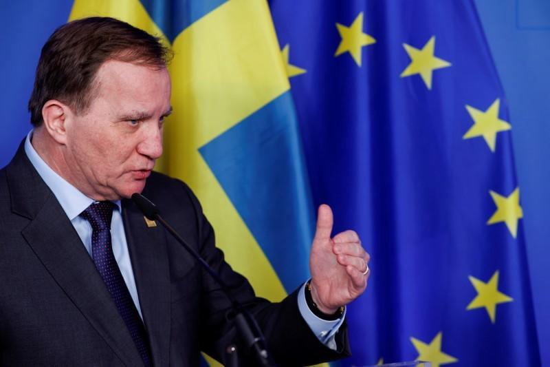 FILE PHOTO: Swedish Prime Minister Stefan Lofven speaks during a news conference after the second day of a European Union summit