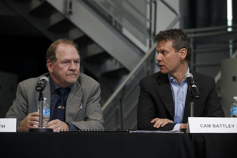Terry Booth, chief executive officer of Aurora Cannabis Inc., left, and Cam Battley, chief corporate officer of Aurora Cannabis Inc., attend a news conference at the Toronto Stock Exchange (TSX) in Toronto, Ontario, Canada, on Monday, May 14, 2018. Aurora Cannabis Inc. agreed to buy rival MedReleaf Corp. for about C$2.9 billion ($2.3 billion) in stock, the companies said Monday in a statement. The deal will create a producer with the capacity to grow 570,000 kilos (1.26 million pounds) a year of cannabis at nine facilities in Canada and two in Denmark. Photographer: Cole Burston/Bloomberg via Getty Images