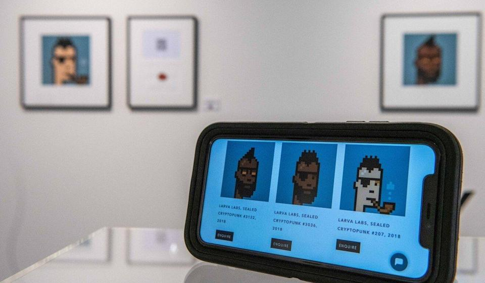 NFTs are displayed at an art gallery in London. Some of the digital assets have sold for millions in recent months. Photo: Bloomberg
