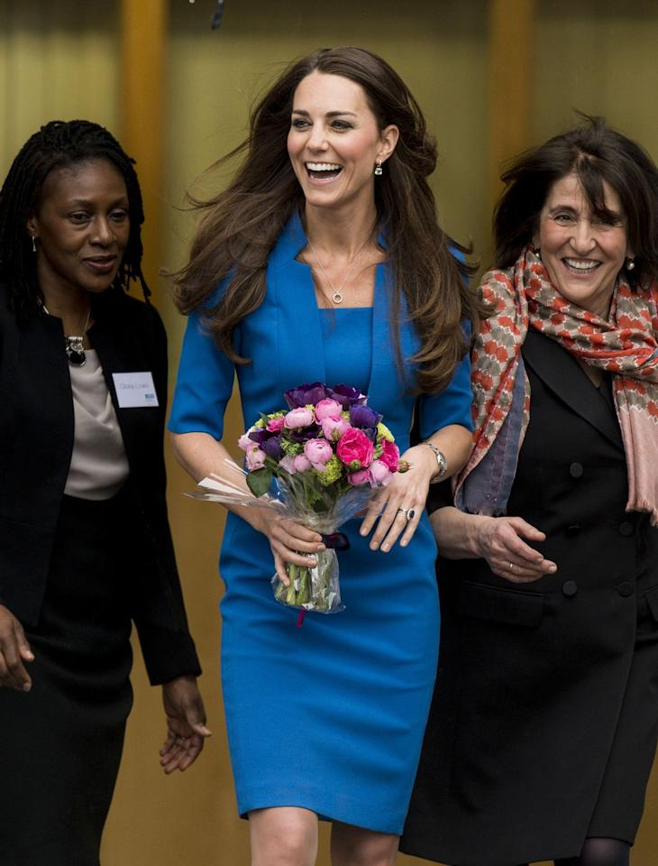 <p>Pop quiz: Is this a new dress, or the same dress? New dress! But also, pretty much the same dress. This one is by L.K. Bennett and has a different neckline. Kate wore it first to the opening of the ICAP Art Room at Northolt High School in England. </p>