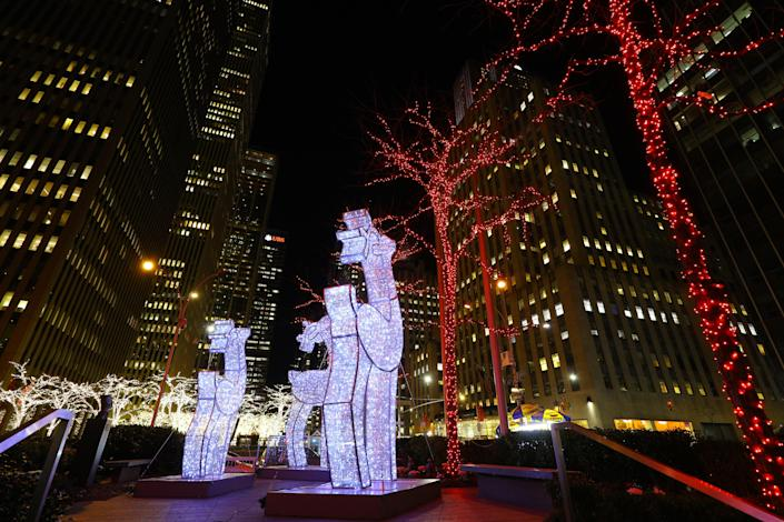 Reindeer made of lights stand tall outside an office building on Sixth Avenue. (Photo: Gordon Donovan/Yahoo News)