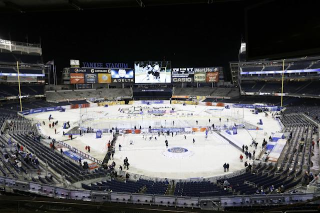 Preperations are made before an outdoor NHL hockey game between the New York Islanders and the New York Rangers Wednesday, Jan. 29, 2014, at Yankee Stadium in New York. (AP Photo/Frank Franklin II)