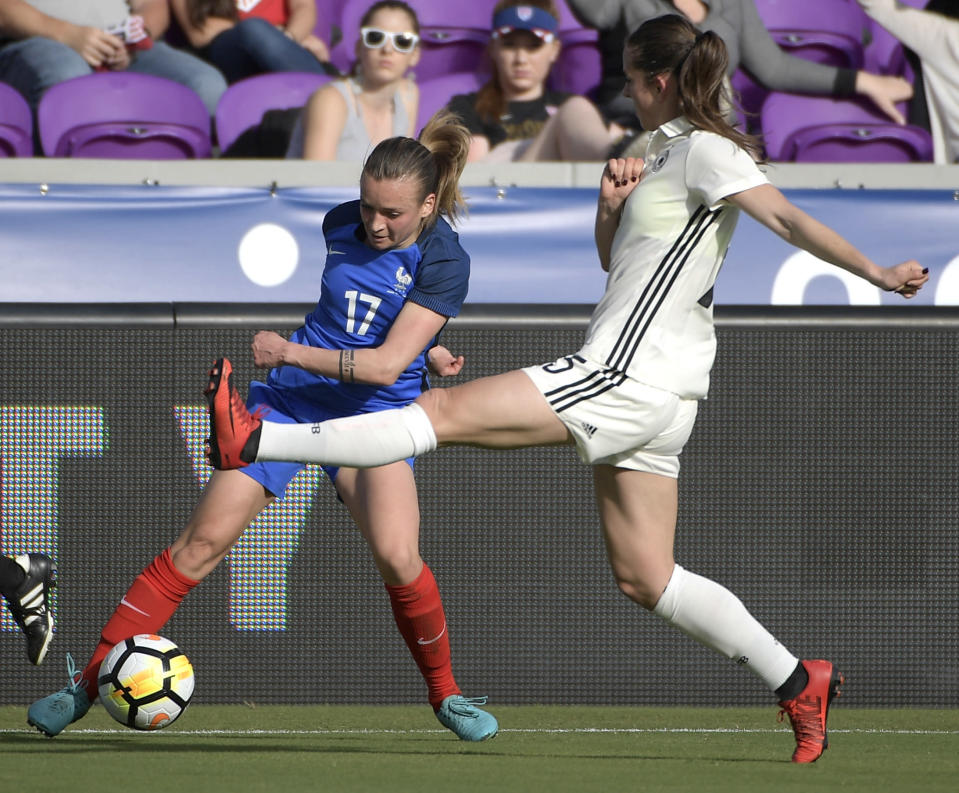 France's Marion Torrent (17) controls a ball in front of Germany's Sara Doorsoun (15) during the first half of a SheBelieves Cup women's soccer match Wednesday, March 7, 2018, in Orlando, Fla. (AP Photo/Phelan M. Ebenhack)