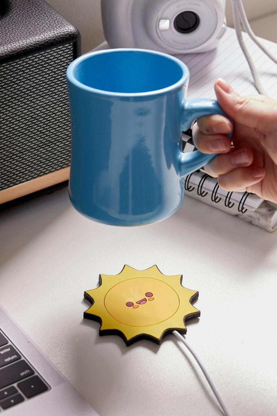 <p>Whether they drink coffee or tea, keep their drinks toasty for longer with this cute yet useful <span>USB Cup Heater</span> ($13). It also comes in a stunning pink and purple butterfly pattern.</p>