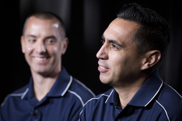 In this May 16, 2018, photo American soccer referees Mark Geiger, left, and Jair Marrufo are interviewed in New York. While the United States is missing from soccer's showcase for the first time since 1986, it is the only nation with two referees working the tournament. Geiger will become the second American to referee at two World Cups. The 43-year-old from Beachwood, New Jersey, worked Chile-Spain and Colombia-Greece during the group stage in Brazil four years ago, then became the first American to work a knockout stage match. Marrufo will be working his first World Cup after getting cut in 2010. (AP Photo/Mark Lennihan)