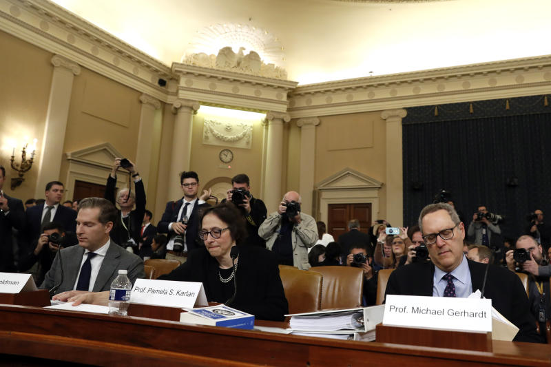 Constitutional law experts, from left, Harvard Law School professor Noah Feldman, Stanford Law School professor Pamela Karlan and University of North Carolina Law School professor Michael Gerhardt arrive to testify during a hearing before the House Judiciary Committee on the constitutional grounds for the impeachment of President Donald Trump, Wednesday, Dec. 4, 2019, on Capitol Hill in Washington. (AP Photo/Jacquelyn Martin)
