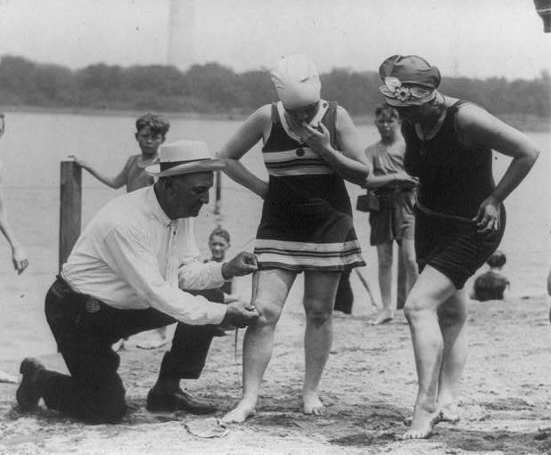 Image of women being policed on modesty by officer on beach 1922