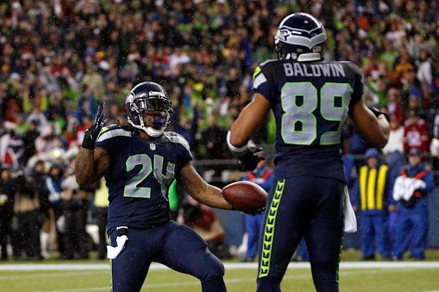 """It wasn't quite the shirt off his back, but <a class=""""link rapid-noclick-resp"""" href=""""/nfl/players/8266/"""" data-ylk=""""slk:Marshawn Lynch"""">Marshawn Lynch</a> still had a very meaningful gift for <a class=""""link rapid-noclick-resp"""" href=""""/nfl/players/25105/"""" data-ylk=""""slk:Doug Baldwin"""">Doug Baldwin</a> when the two played for the <a class=""""link rapid-noclick-resp"""" href=""""/nfl/teams/sea"""" data-ylk=""""slk:Seahawks"""">Seahawks</a>. (AP Photo)"""