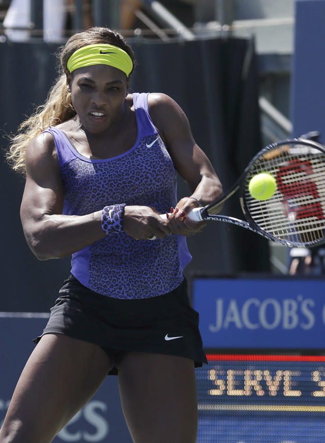 Serena Williams, of the United States, returns the ball to Andrea Petkovic, from Germany, during the first set of a semifinal in the Bank of the West Classic tennis tournament in Stanford, Calif., Saturday, Aug. 2, 2014. (AP Photo/Jeff Chiu)