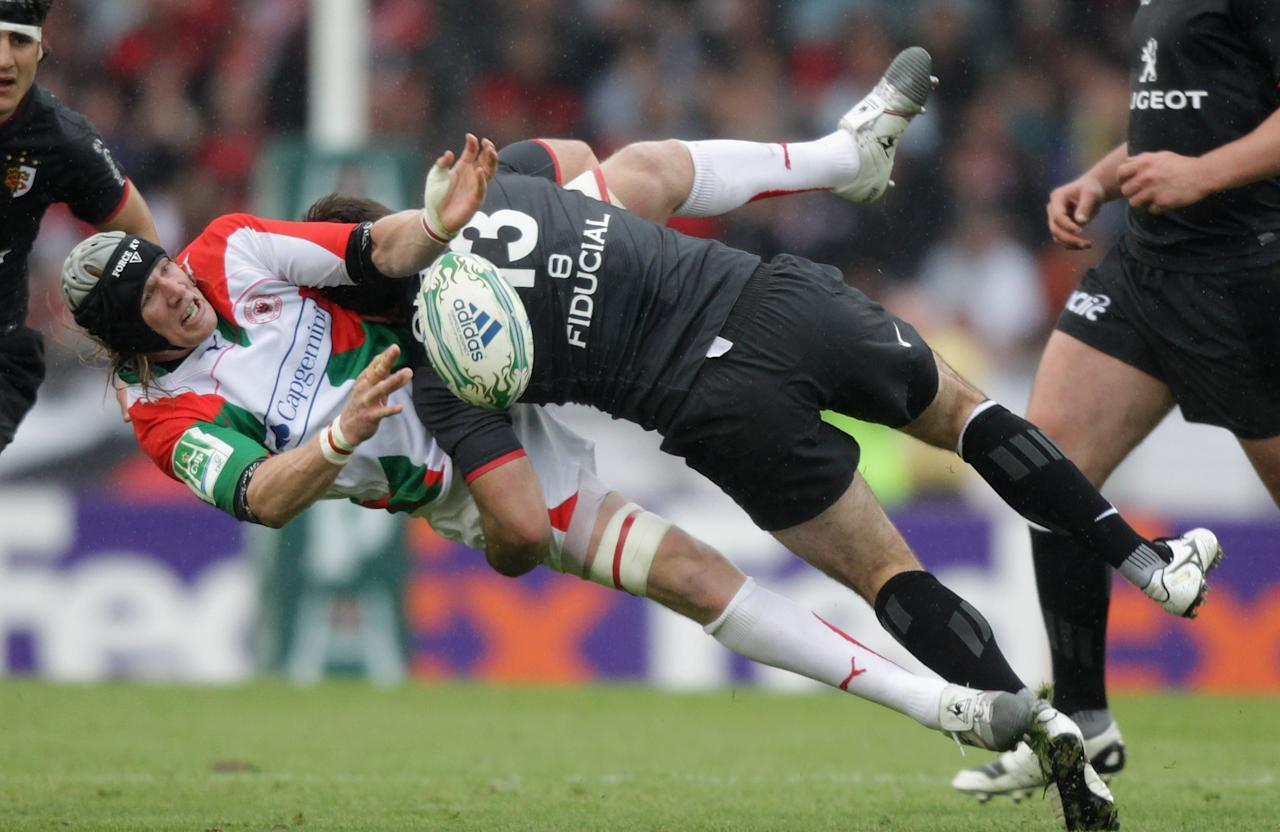 SAN SEBASTIAN, SPAIN - APRIL 10:  Magnus Lund of Biarritz is tackled by Florian Fritz during the Heineken Cup quarter final match between Biarritz Olympic and Toulouse at Estadio Anoeta on April 10, 2011 in San Sebastian, Spain.  (Photo by David Rogers/Getty Images) *** BESTPIX ***