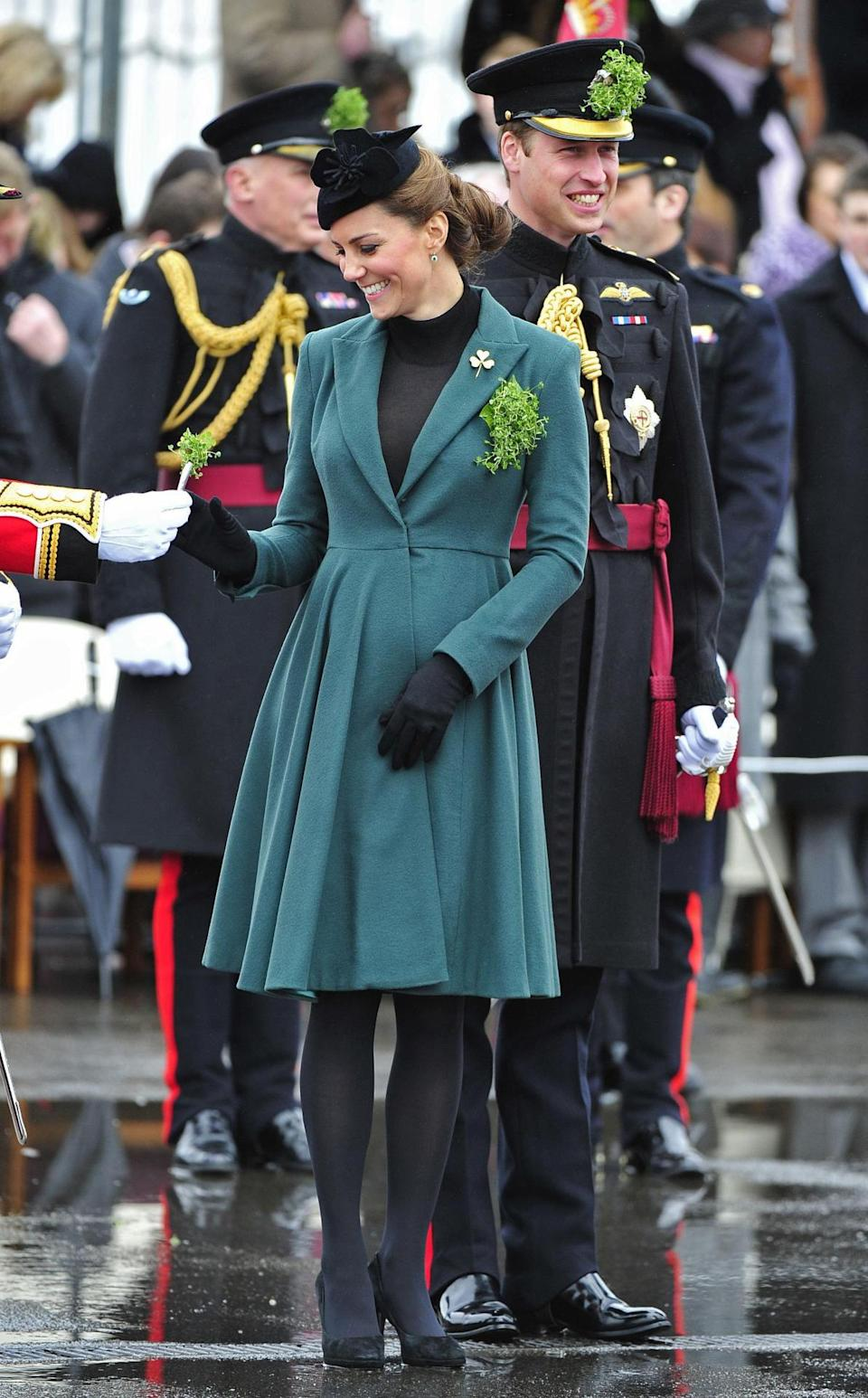 <p>Kate attended a St. Patrick's Day parade in a dark green Emilia Wickstead coat, a black Lock & Co hat and suede Episode heels. </p><p><i>[Photo: PA]</i></p>