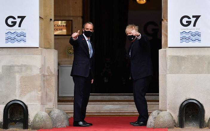 Boris Johnson and Dominic Raab outside Lancaster House in London - Getty