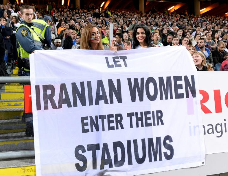 Supporters hold a banner calling for Iranian women to be allowed to enter football stadiums, during a match between Sweden and Iran in Solna near Stockholm on March 31, 2015