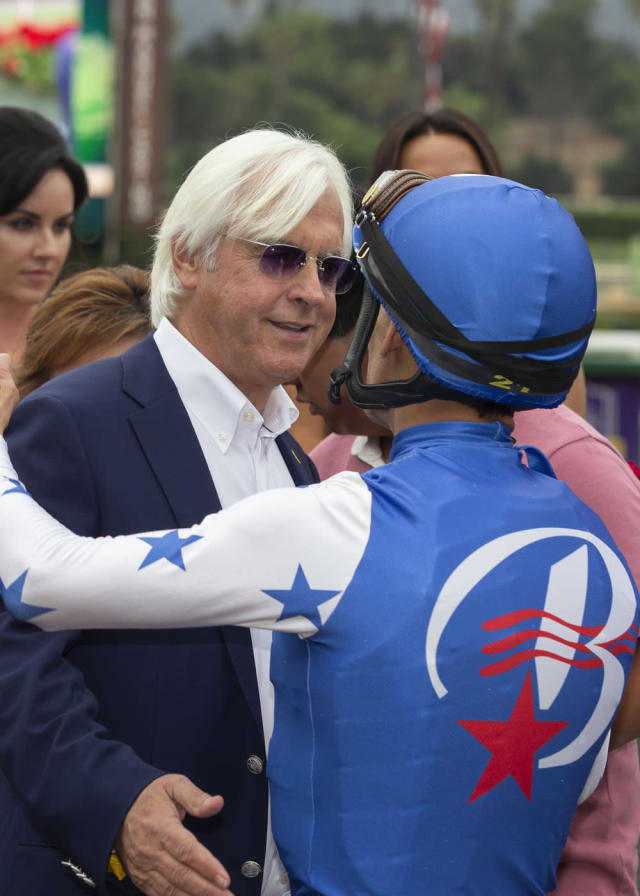 In this image provided by Benoit Photo, winning trainer Bob Baffert, front left, congratulates John Velazquez, right, for the win with Bast in the Grade I $300,000 Chandelier Stakes horse race Friday, Sept. 27, 2019, at Santa Anita Park in Arcadia, Calif. (Benoit Photo via AP)