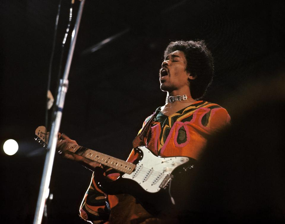 American rock guitarist and singer Jimi Hendrix (1942-1970) performs live on stage playing a black Fender Stratocaster guitar at the 1970 Isle of Wight Festival at Afton Down on the Isle of Wight on the night of 30th-31st August 1970. (Photo by David Redfern/Redferns)