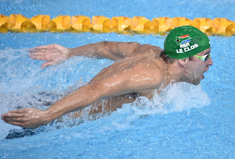 South Africa's Chad le Clos swims to gold in the Men's 200m Butterfly Final at the Tollcross International Swimming Centre during the 2014 Commonwealth Games in Glasgow on July 26, 2014 (AFP Photo/Andrej Isakovic)