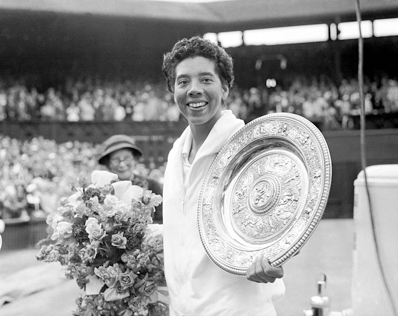 Althea Gibson with the Wimbledon trophy after her straight sets victory over Angela Mortimer. (Photo by Barratts/PA Images via Getty Images)