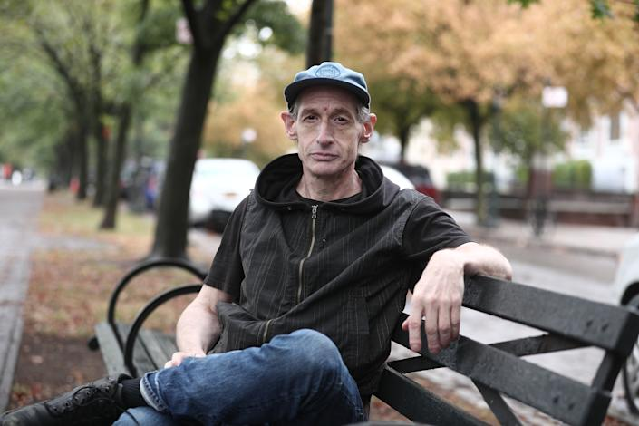 Former college music professor David Shohl sits on a park bench along the Eastern Parkway in the Crown Heights section of Brooklyn. (Photo: Gordon Donovan/Yahoo News)