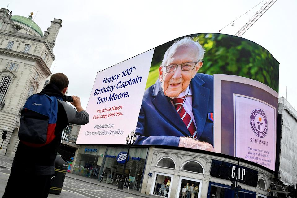 A happy birthday message is displayed on the big screen in Piccadilly Circus for army veteran Captain Tom Moore on his 100th birthday, following the outbreak of the coronavirus disease (COVID-19), in London, Britain, April 30, 2020.  REUTERS/Toby Melville     TPX IMAGES OF THE DAY