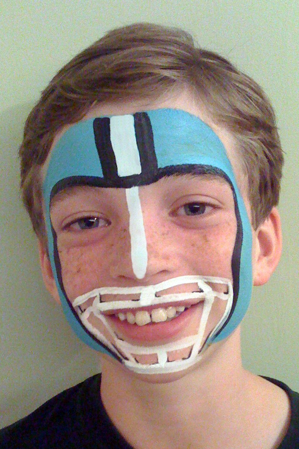 "<p>A favorite jersey paired with this helmet-themed face paint (in team colors, of course!) will definitely score you a big W with your little athlete.<br><br><em><a href=""https://facepaintingbytrudy.com/"" rel=""nofollow noopener"" target=""_blank"" data-ylk=""slk:See more at Face Painting by Trudy »"" class=""link rapid-noclick-resp"">See more at Face Painting by Trudy »</a></em><br></p>"